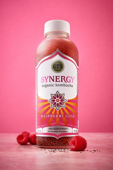 Synergy organic kombucha with pink background and raspberries - drink photography -