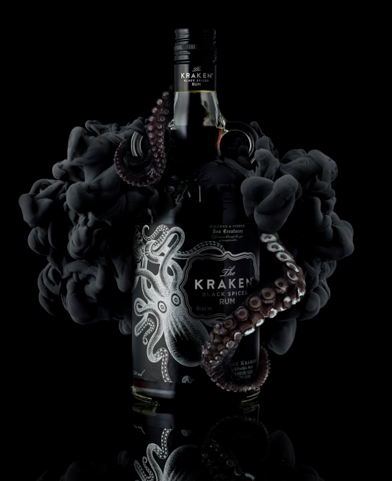 A bottle of kraken rum with tentacles and ink plumes - drink liquor photography