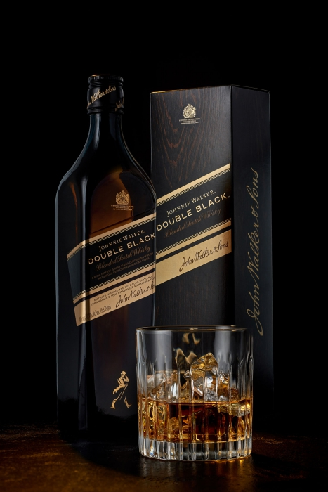 a bottle of jonnie walker double black with glass - drink liquor photography