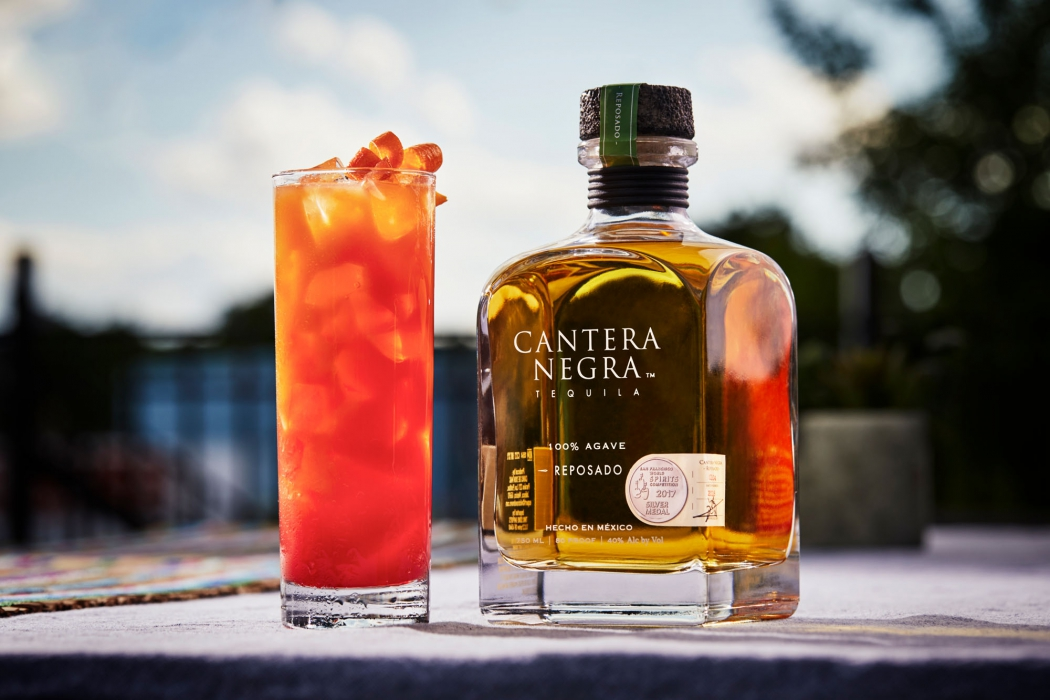Reposado tequila with a tequila sunrise - Cantera Negra Tequila - Drink Liquor Photography
