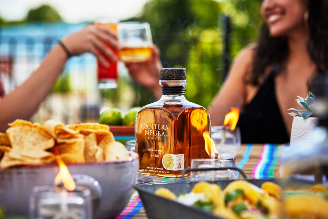 Anejo Tequila served at a dinner party with friends- Cantera Negra Tequila - Drink Liquor Photography