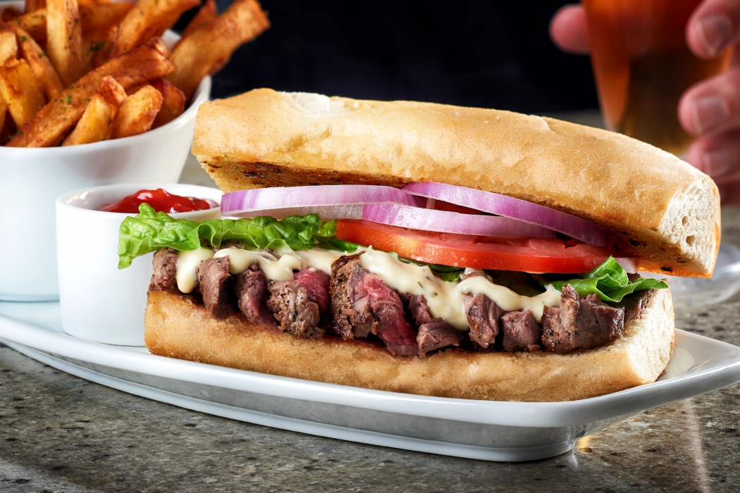 A delicious fresh steak sandwich with fries - food photography