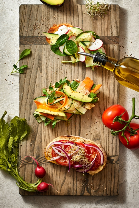 A board of fresh raw food on toast well styled - food photography