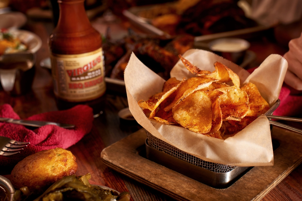 A feature of BBQ potato chips in a basket at a dinner table - food photography