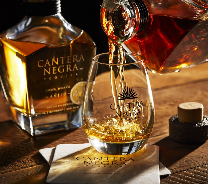 A pour of cantera negra tequila - splash and pours - drink photogaphy