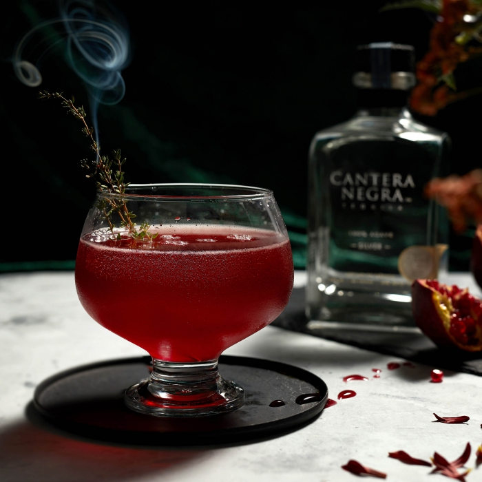 A smoking deathly hallows cocktail - drink photography
