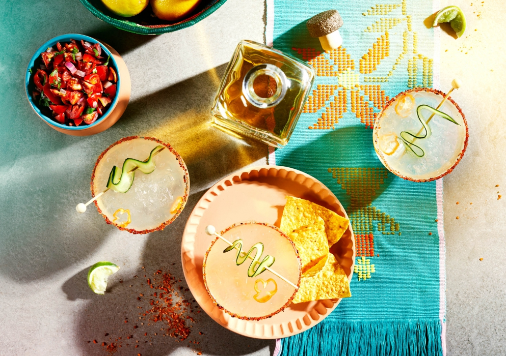 Overhead a spicy margarita with garnishes - drink cocktail photography