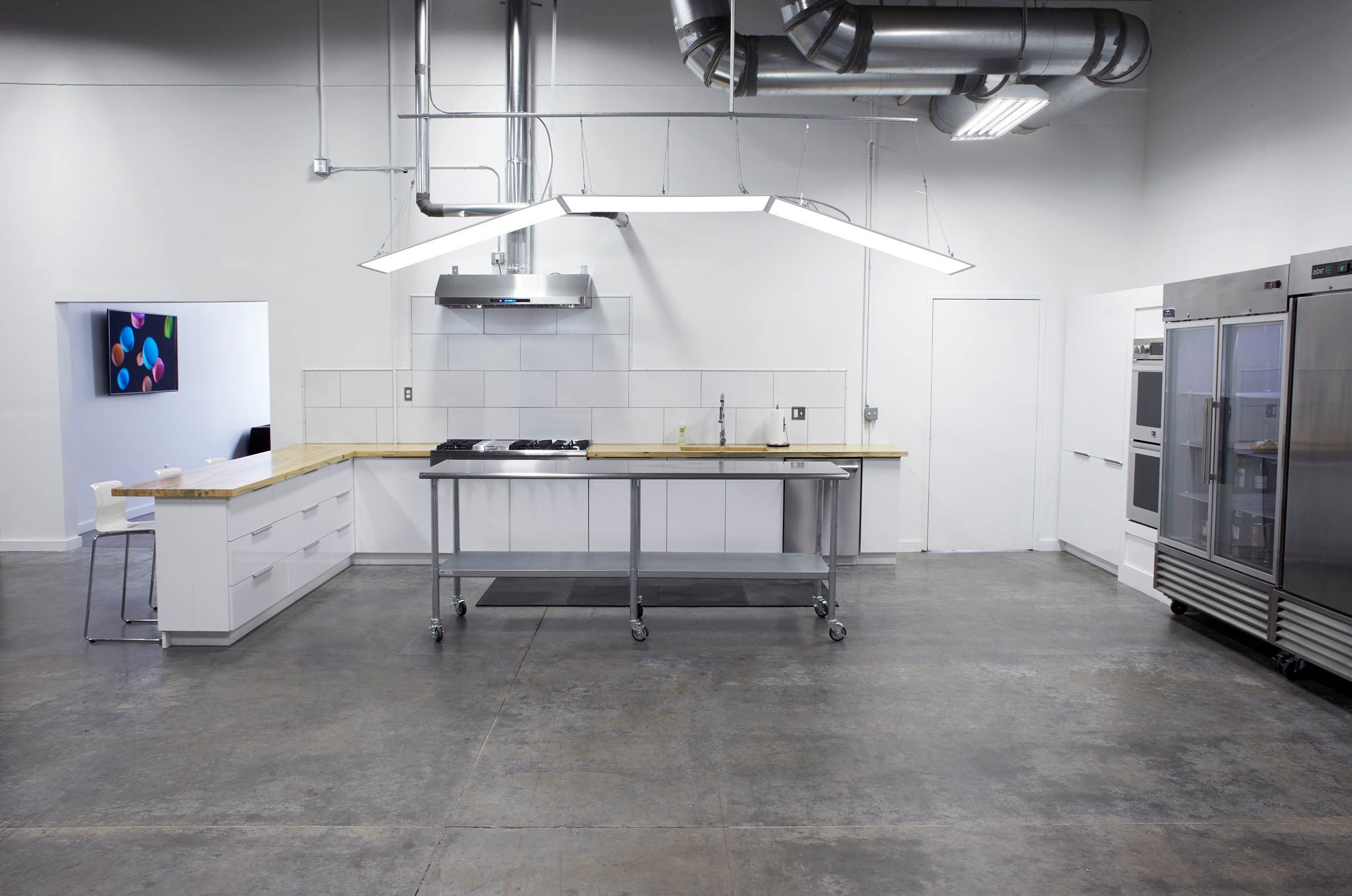an alternate view of modern kitchen of OMS Photo's Golden Colorado photo studio